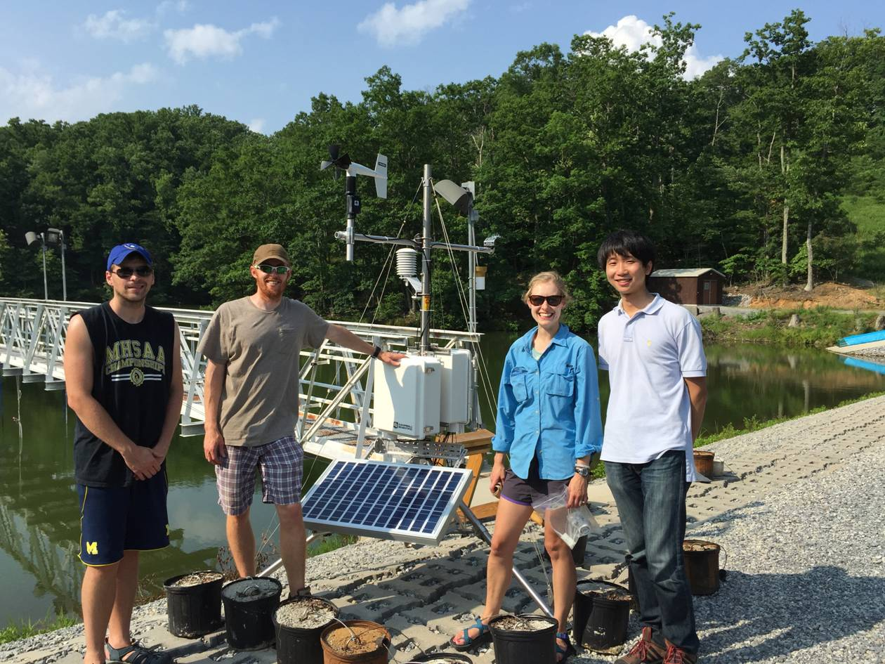 Sensor team deploying a new meteorological station at Falling Creek Reservoir (Photo credit: B. Niederlehner)